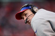 Dec 7, 2014; Denver, CO, USA; Buffalo Bills head coach Doug Marrone looks at the score board in the fourth quarter against the Denver Broncos at Sports Authority Field at Mile High. The Broncos defeated the Bills 24-17. Mandatory Credit: Ron Chenoy-USA TODAY Sports