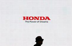 A man is silhouetted against a logo of Honda Motor at the company's showroom in Tokyo, Japan, May 13, 2016.   REUTERS/Toru Hanai - RTX2E4NU