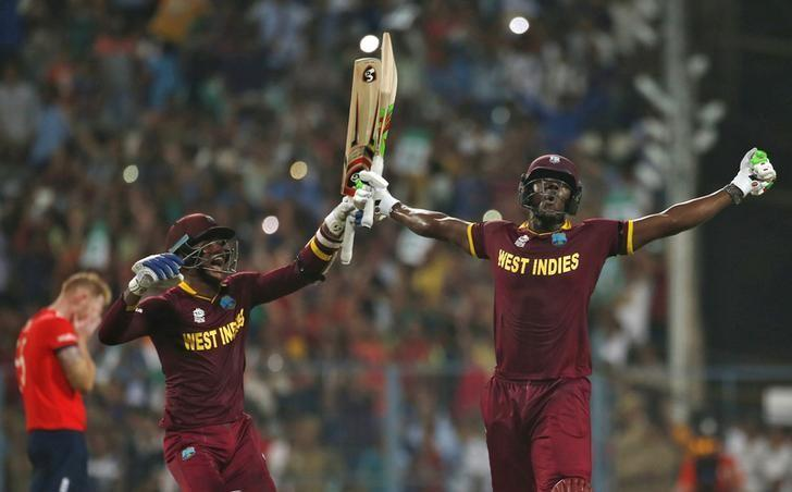 Cricket - England v West Indies - World Twenty20 cricket tournament final - Kolkata, India - 03/04/2016. West Indies Carlos Brathwaite (R) and Marlon Samuels celebrate after winning the final.    REUTERS/Adnan Abidi