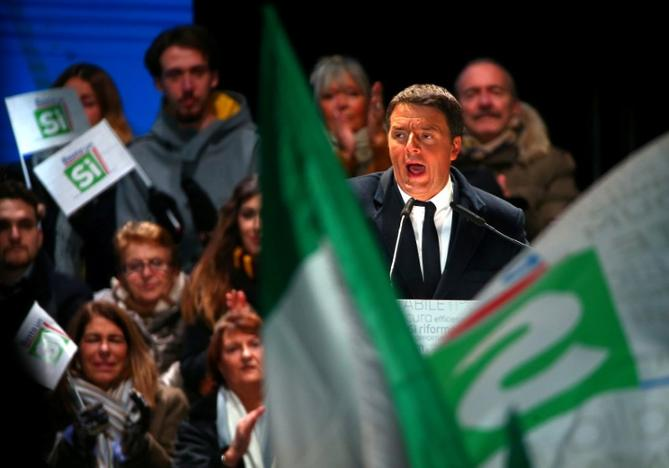 FILE PHOTO: Italian Prime Minister Matteo Renzi speaks during the last rally for a 'Yes' vote in the referendum about constitutional reform, in Florence, Italy, December 2, 2016. REUTERS/Alessandro Bianchi/File Photo