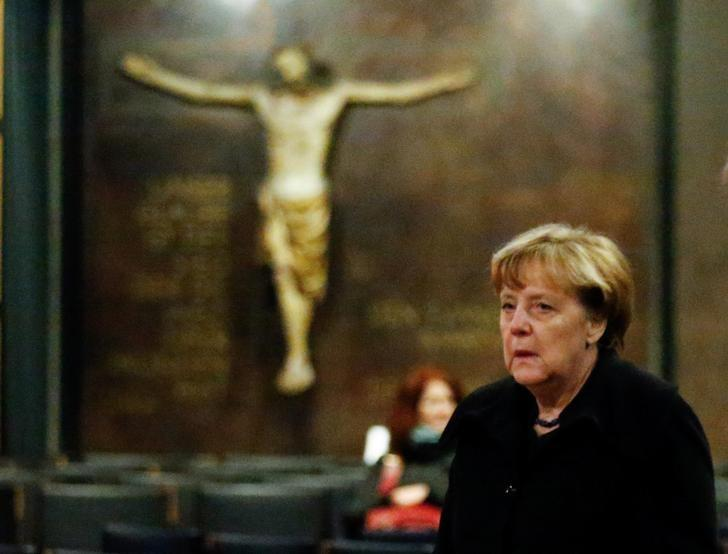 German Chancellor Angela Merkel arrives to sign the condolence book at the Gedaechniskirche in Berlin, Germany, December 20, 2016, one day after a truck ploughed into a crowded Christmas market in the German capital.       REUTERS/Hannibal Hanschke
