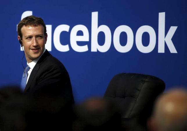 Facebook CEO Mark Zuckerberg is seen on stage during a town hall at Facebook's headquarters in Menlo Park, California September 27, 2015. REUTERS/Stephen Lam/File Photo
