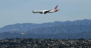 An American Airlines plane is pictured during its approach to Los Angeles International airport in Los Angeles, California February 11, 2015.  REUTERS/Mario Anzuoni