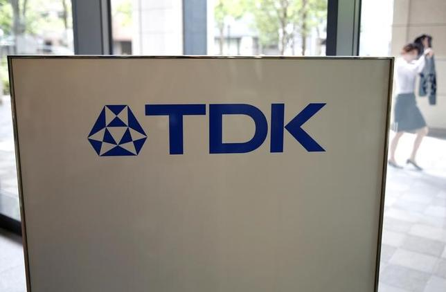 The logo of TDK Corp. is displayed at the entrance of the company headquarters building in Tokyo, Japan, July 6, 2016. REUTERS/Issei Kato/Files