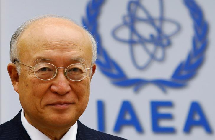 International Atomic Energy Agency (IAEA) Director General Yukiya Amano smiles as he waits for a board of governors meeting to begin at the IAEA headquarters in Vienna, Austria June 6, 2016. REUTERS/Heinz-Peter Bader/Files