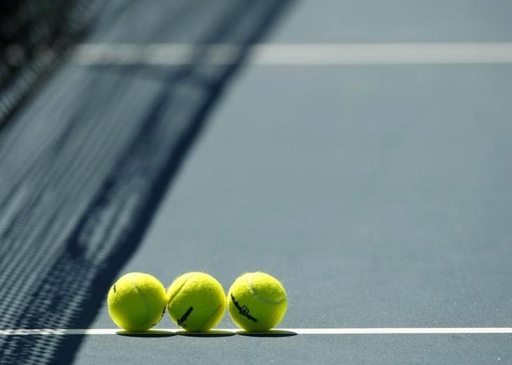 Tennis balls sit on the court before a match at the Australian Open tennis tournament in Melbourne January 23, 2008. Photo taken January 23, 2008. REUTERS/Petar Kujundzic/File Photo