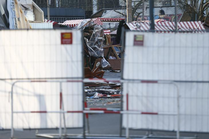 Remains of a wooden christmas booth at the Christmas market in Berlin, Germany, December 21, 2016, after a truck ploughed through a crowd at the Christmas market on Monday night.    REUTERS/Hannibal Hanschke