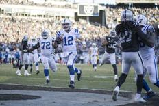 December 24, 2016; Oakland, CA, USA; Indianapolis Colts quarterback Andrew Luck (12) scores a touchdown against the Oakland Raiders during the fourth quarter at Oakland Coliseum. Mandatory Credit: Kyle Terada-USA TODAY Sports