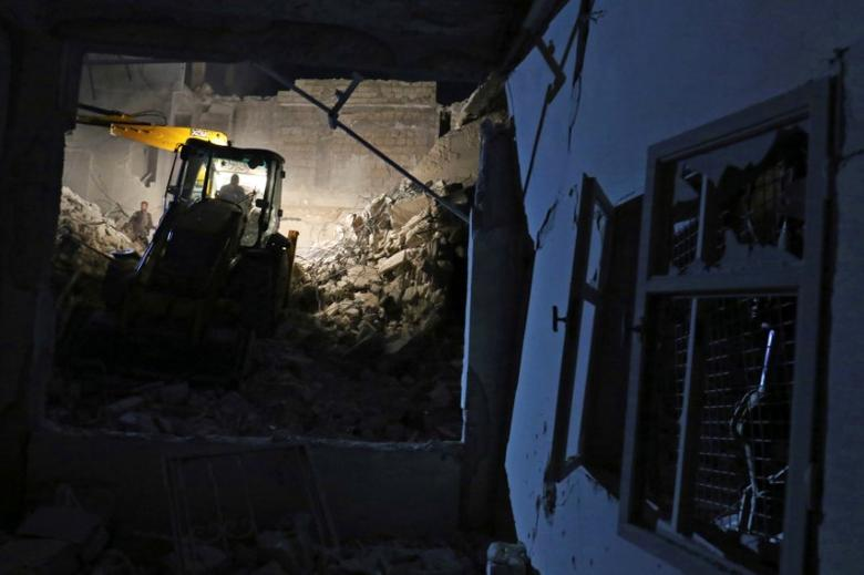 Civil defence members work at a site hit at night by an airstrike in Saraqeb, in rebel-held Idlib province, Syria December 11, 2016. REUTERS/Ammar Abdullah