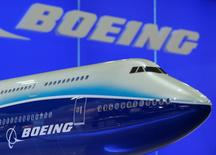 A model of Boeing 747 passenger plane is displayed at the Asian Aerospace Expo in Hong Kong September 8, 2009.   REUTERS/Bobby Yip/File Photo