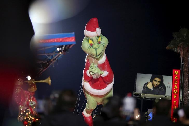 A Dr. Seuss The Grinch balloon appears in the 84th Annual Hollywood Christmas Parade in the Hollywood section of Los Angeles, California, November 29, 2015. REUTERS/David McNew/File Photo