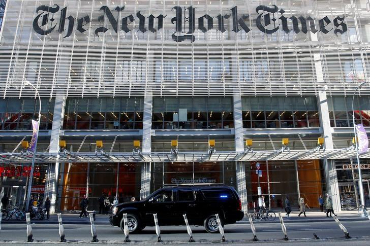 The motorcade of U.S. President-elect Donald Trump makes its way past the New York Times building after a meeting in New York U.S., November 22, 2016. REUTERS/Shannon Stapleton