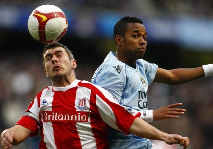 Manchester City's Robinho (R) challenges Stoke City's Andy Griffin (L) during their English Premier League soccer match in Manchester, northern England October 26, 2008. REUTERS/Phil Noble/File Photo