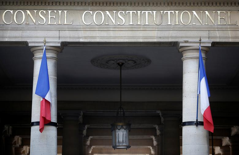 French flags hang outside the entrance of the Constitutional Council (Conseil Constitutionnel) in Paris, France April 10, 2014.  REUTERS/Christian Hartmann/File Photo