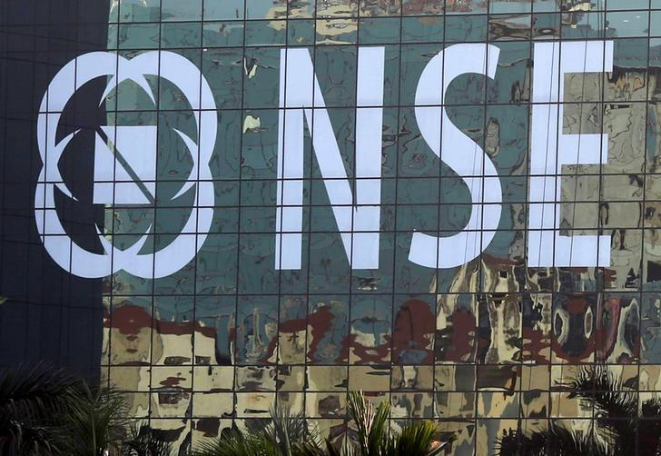 Buildings are reflected on the glass windows of the NSE (National Stock Exchange) building in Mumbai, India, December 27, 2016. Picture taken December 27, 2016. REUTERS/Shailesh Andrade