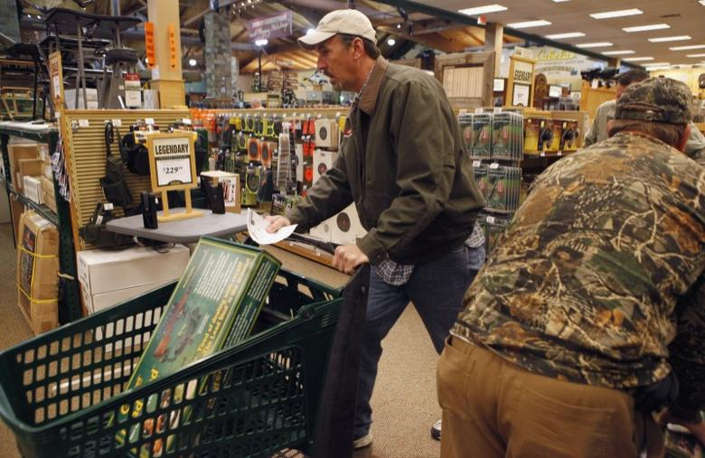 Shoppers rush to grab items inside a Cabela's store on the shopping day dubbed ''Black Friday'' in Fort Worth, Texas November 27, 2009. REUTERS/Jessica Rinaldi
