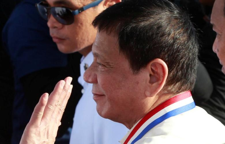 President Rodrigo Duterte waves to supporters as he leads the death anniversary celebration of Filipino national hero Dr Jose Rizal in Manila, Philippines December 30, 2016.  REUTERS/Czar Dancel - RTX2WWUM