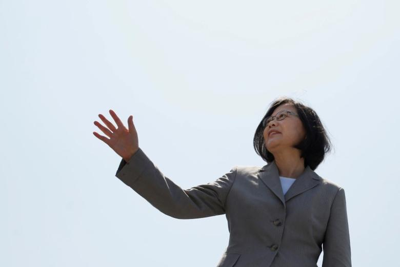 FILE PHOTO: Taiwanese President Tsai Ing-wen waves her hand as she boards the nation's first domestically built Tuo Jiang twin-hull stealth missile corvette at Suao Naval Base in Yilan, Taiwan June 4, 2016. REUTERS/Tyrone Siu/File Photo