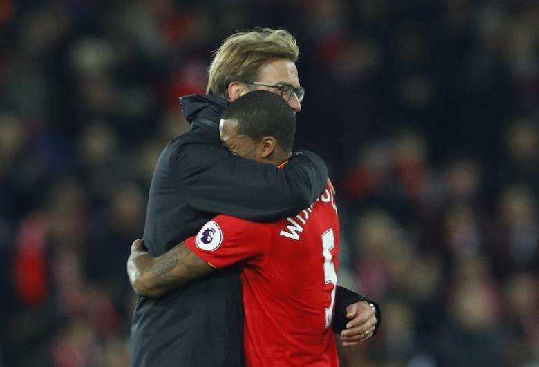 Britain Football Soccer - Liverpool v Manchester City - Premier League - Anfield - 31/12/16 Liverpool manager Juergen Klopp and Liverpool's Georginio Wijnaldum celebrate after the game  Reuters / Phil Noble Livepic