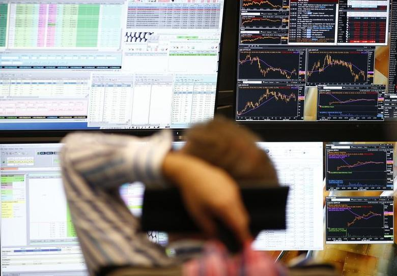 A trader sits in front of the computer screens at his desk at the Frankfurt stock exchange, Germany, June 29, 2015.  REUTERS/Ralph Orlowski/Files