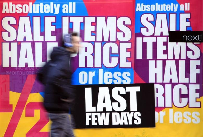 A pedestrian walks past a Next shop in Covent Garden in London January 5, 2011. REUTERS/Stefan Wermuth