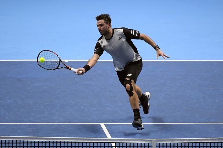 Switzerland's Stanislas Wawrinka in action during his round robin match against Great Britain's Andy Murray  Reuters / Toby Melville Livepic