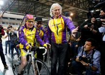 French cyclist Robert Marchand (L) prepares to start as he attempts to break his own world cycling record at the age of 105, taking part in a one-hour cycling event in the Masters + 100 category held at the Velodrome National in Montigny-les-Bretonneux, southwest of Paris, France, January 4, 2017. REUTERS/Jacky Naegelen