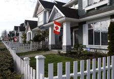 Canadian flags are seen on houses in the Vancouver suburb of Richmond February 9, 2010.  REUTERS/Chris Helgren