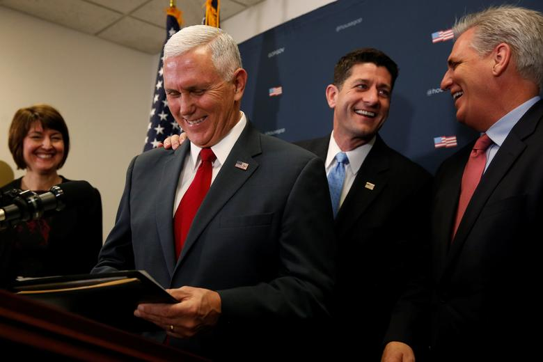 U.S. Vice President-elect Mike Pence (2nd L) joins House Republicans, including Speaker Paul Ryan (R-WI) (2nd R), Majority Leader Kevin McCarthy (R-CA) (R) and Representative Cathy McMorris Rodgers (R-WA) (L), to speak to reporters after meeting with the Republican House caucus at the U.S. Capitol in Washington, U.S. January 4, 2017. REUTERS/Jonathan Ernst