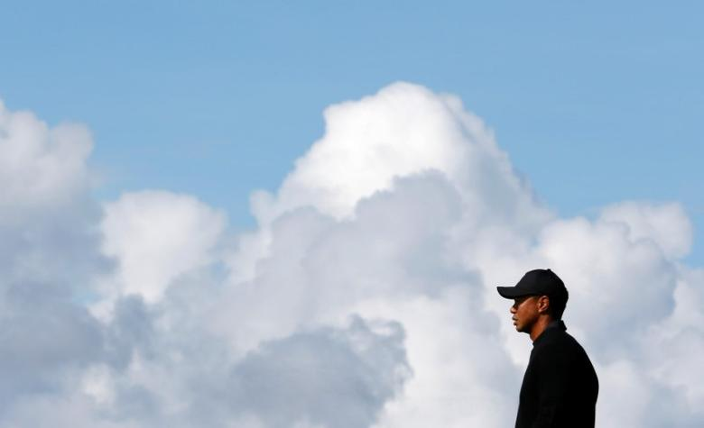 Tiger Woods of the U.S. stands on the 12th green during a practice round ahead of the British Open Championship at the Royal Liverpool Golf Club in Hoylake, northern England July 15, 2014.        REUTERS/Stefan Wermuth/File Photo