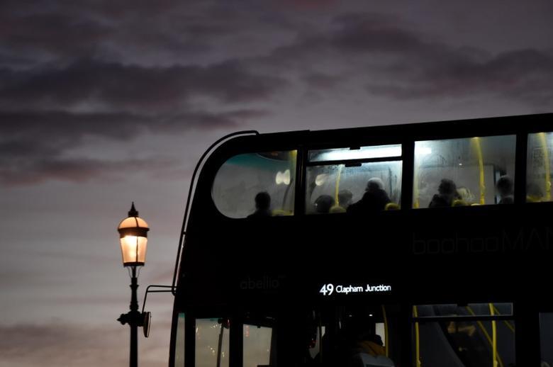 A bus drives across a bridge as the sun sets over the Chelsea area in London, Britain December 11, 2016. REUTERS/Clodagh Kilcoyne