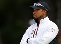 Team USA vice-captain Tiger Woods talk at the 13th green during the practice round for the Ryder Cup at Hazeltine National Golf Club in Chaska, Minnesota, September 28, 2016.  Mandatory Credit: Michael Madrid-USA TODAY Sports/File photo - RTSRO9L