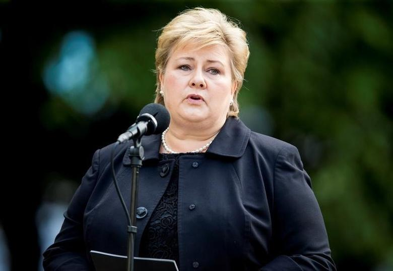 Norway's Prime Minister Erna Solberg speaks during a wreath laying ceremony outside a government building on the fifth anniversary of the attacks by mass killer Anders Behring Breivik in Oslo, Norway July 22, 2016.  NTB Scanpix/Vegard Wivestad Groett/ via REUTERS/File Photo
