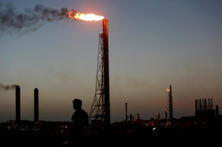 A man stands close to the Cardon refinery, which belongs to the Venezuelan state oil company PDVSAn in Punto Fijo, Venezuela, July 22, 2016.  REUTERS/Carlos Jasso/File Photo