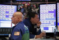 Traders work on the floor of the New York Stock Exchange (NYSE) shortly after the opening bell in New York, U.S., January 5, 2017. REUTERS/Lucas Jackson