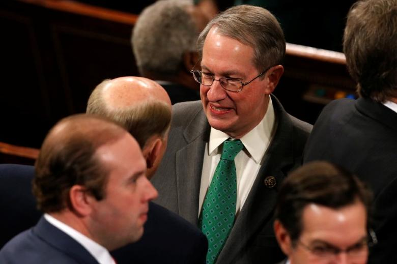 U.S. House Judiciary Committee Chairman Bob Goodlatte (R-VA) speaks with fellow members on the House floor on the first day of the new session of Congress in Washington, U.S. January 3, 2017. REUTERS/Jonathan Ernst