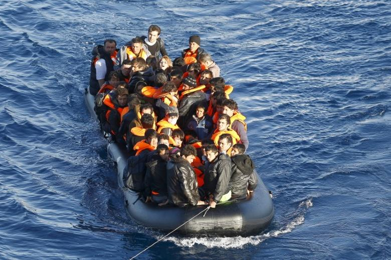 A dinghy full of refugees and migrants is towed by a Turkish Coast Guard fast rigid-hulled inflatable boat (not seen) on the Turkish territorial waters of the North Aegean Sea, following a failed attempt of crossing to the Greek island of Chios, off the shores of Izmir, Turkey, February 28,  2016. REUTERS/Umit Bektas