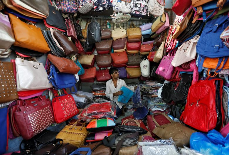 A vendor arranges bags as he waits for customers at his shop at a market in Mumbai, India, January 6, 2017. REUTERS/Danish Siddiqui