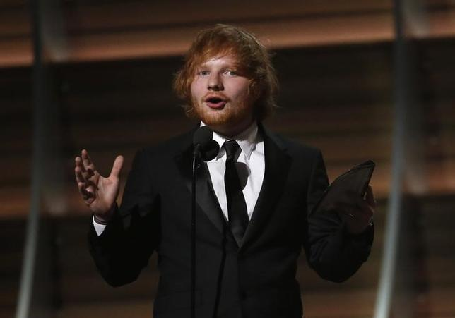 Ed Sheeran accepts the award for Song of the Year for ''Thinking Out Loud'' at the 58th Grammy Awards in Los Angeles, California, U.S. on February 15, 2016.  REUTERS/Mario Anzuoni/File Photo