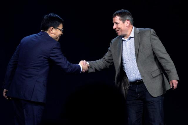 Steve Rabuchin, Amazon president of Amazon Alexa (R) shakes hands with Richard Yu, CEO of Huawei Consumer Business Group during the Huawei keynote address at CES in Las Vegas, January 5, 2017.  REUTERS/Rick Wilking