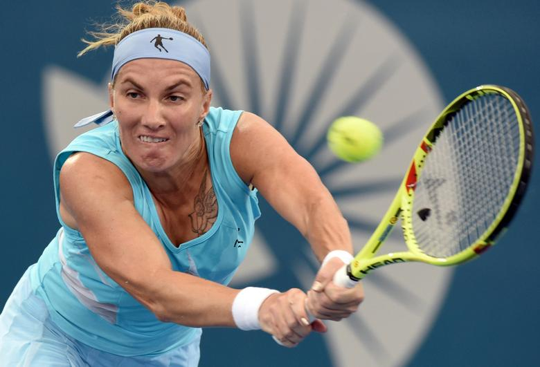 Tennis - Brisbane International - Pat Rafter Arena, Brisbane, Australia - 5/1/17 Russia's Svetlana Kuznetsova reaches to hit a shot during her match against Spain's Garbine Muguruza.   REUTERS/Steve Holland