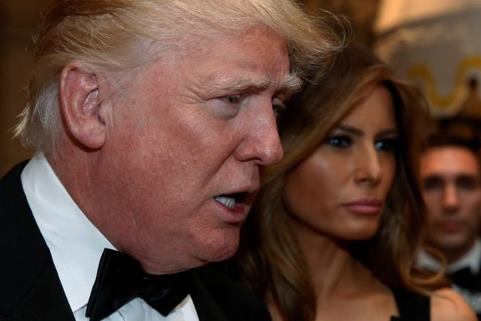 U.S. President-elect Donald Trump talks to reporters as he and his wife Melania Trump arrive for a New Year's Eve celebration with members and guests at the Mar-a-lago Club in Palm Beach, Florida, U.S. December 31, 2016. REUTERS/Jonathan Ernst