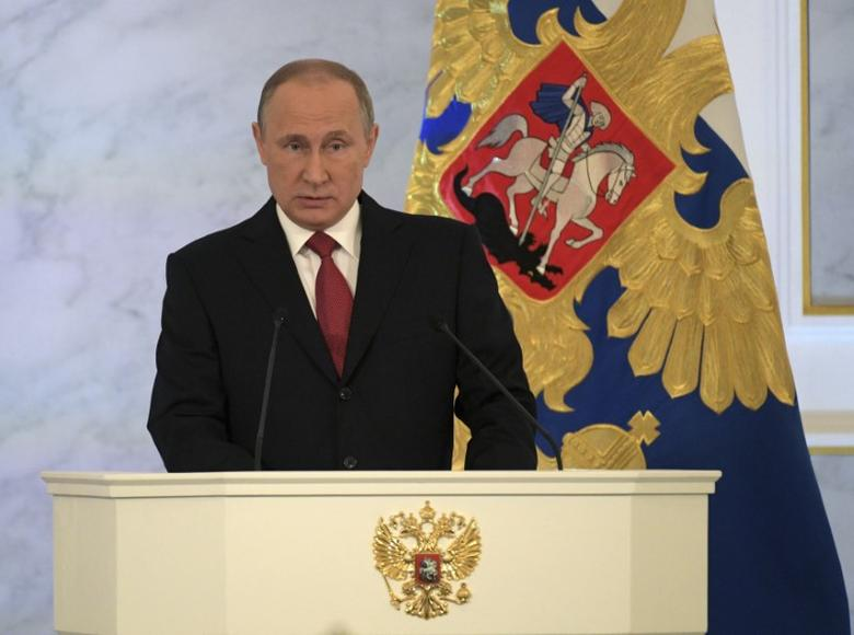 Russian President Vladimir Putin delivers a speech during his annual state of the nation address at the Kremlin in Moscow, Russia, December 1, 2016. Sputnik/Kremlin/Alexei Druzhinin via REUTERS