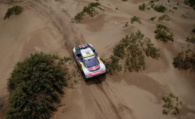 Dakar Rally - 2017 Paraguay-Bolivia-Argentina Dakar rally - 39th Dakar Edition - Fifth stage from Tupiza to Oruro, Bolivia 06/01/17. Stephane Peterhansel of France drives his Peugeot with his copilot Jean Paul Ottret. REUTERS/Ricardo Moraes