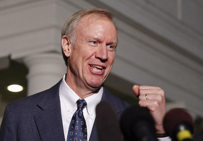 Illinois Gov-elect Bruce Rauner talks to the media after a meeting with U.S. President Barack Obama at the White House in Washington December 5, 2014. REUTERS/Larry Downing/File Photo