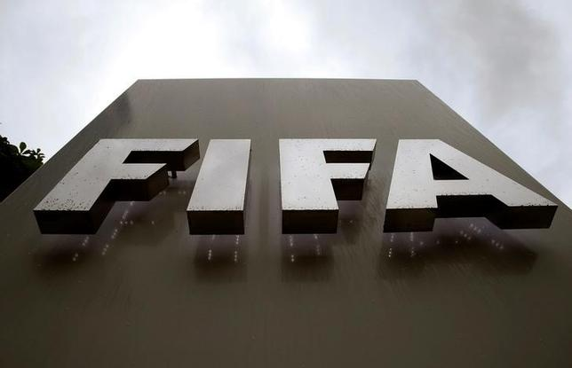 Raindrops flow down on a logo in front of FIFA's headquarters in Zurich, Switzerland June 8, 2016. REUTERS/Arnd Wiegmann/Files