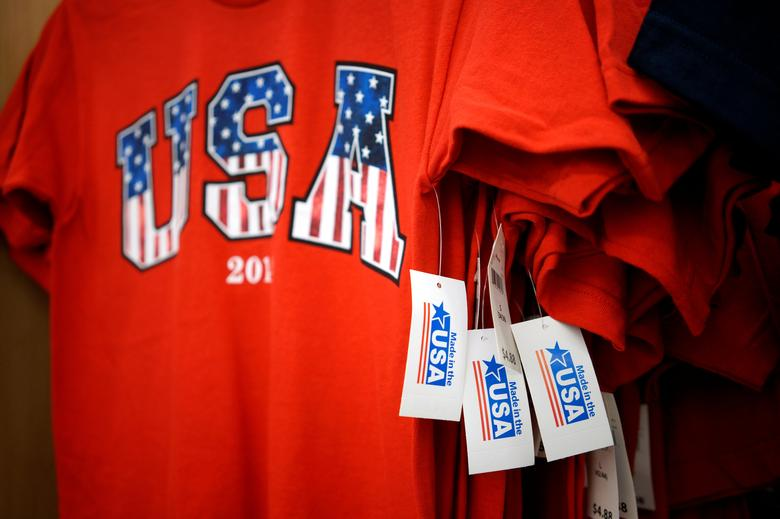 File Photo: T-shirts made in the USA are for sale at the Walmart Supercenter in Bentonville, Arkansas June 5, 2014.  The Walmart Stores Inc. annual shareholder meeting takes place June 6, 2014. REUTERS/Rick Wilking/File Photo