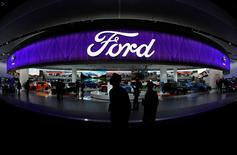 People walk by the Ford display during the North American International Auto Show in Detroit, Michigan, U.S., January 10, 2017. REUTERS/Mark Blinch