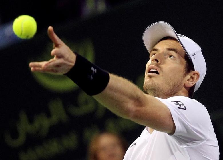 Tennis - Qatar Open - Men's singles final - Andy Murray of Britain v Novak Djokovic of Serbia - Doha, Qatar - 7/1/2017 - Murray serves the ball. REUTERS/Naseem Zeitoon