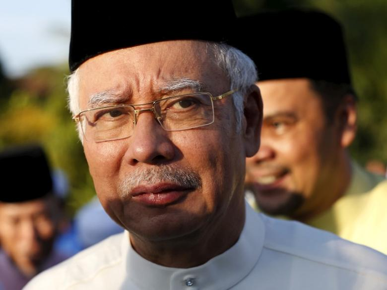 FILE PHOTO - Malaysia's Prime Minister Najib Razak arrives for a news conference at a mosque outside Kuala Lumpur, Malaysia, July 5, 2015.   REUTERS/Olivia Harris/File Photo